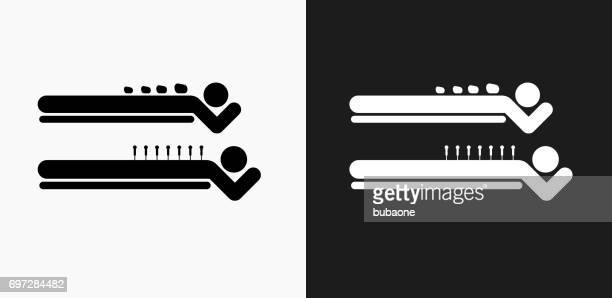 spa rock massage icon on black and white vector backgrounds - acupuncture stock illustrations, clip art, cartoons, & icons