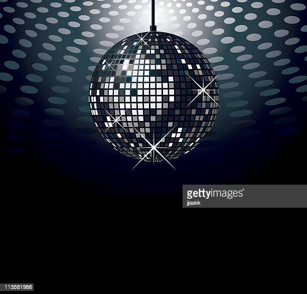 Sparkling disco ball over dark background with lights above