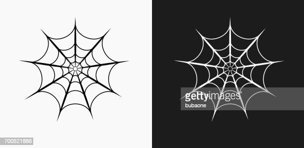 spider web icon on black and white vector backgrounds - spider stock illustrations