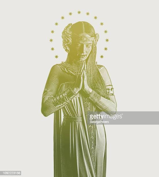 spiritual woman praying - religious saint stock illustrations