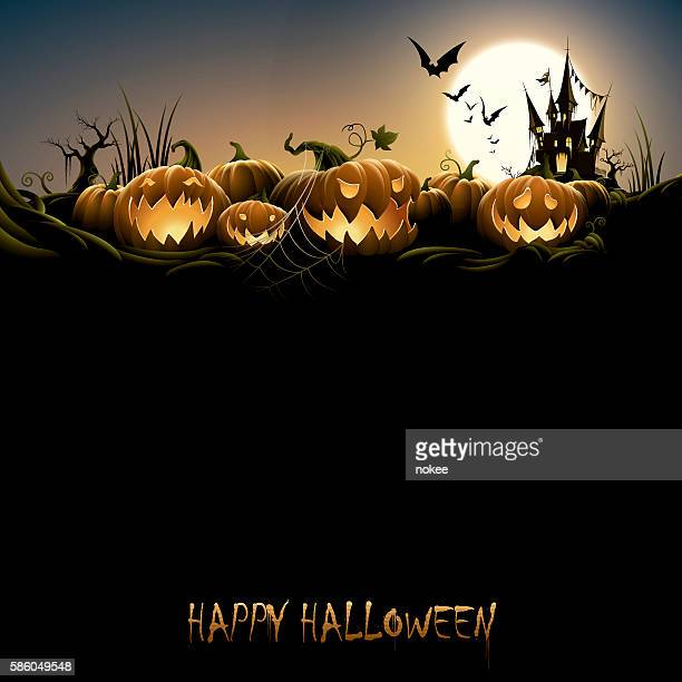 Spooky halloween night with pumpkins and haunted castle
