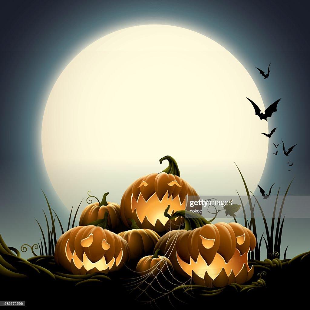 Spooky Halloween night with pumpkins