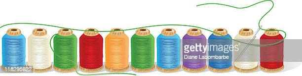 Spools of Thread in a Row