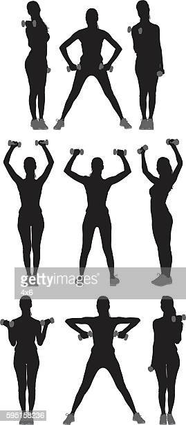 sports woman exercising with dumbbells - weight training stock illustrations