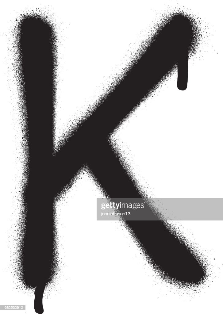 sprayed K font graffiti with leak in black over white