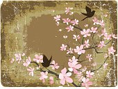 Spring Cherry blossoms And Sparrows On Brown Grunge Background