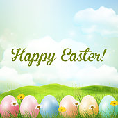 Spring meadow background with easter colorful eggs