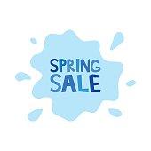 Spring sale inscription on background rain puddles splashing.