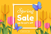 Spring sale promo banner with paper flowers and butterflies. Spring colorful background with frame and copy space. Origami yellow and pink tulips. Vector illustration.