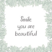 "Square floral frame.  ""Smile your are beautiful"" lettering quote."