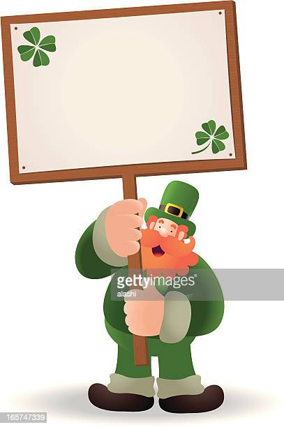 St. Patrick's day: Happy Leprechaun Holding A Blank Sign