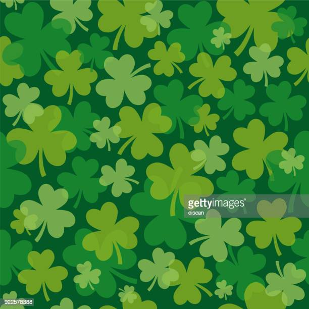 st. patrick's day seamless pattern with clover - day stock illustrations
