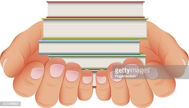 Stapel Bücher in der hand