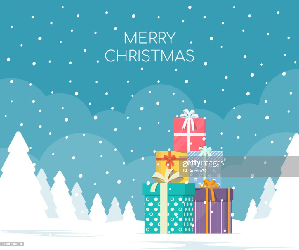 Stack of gift boxes on winter landscape background. Christmas concept.