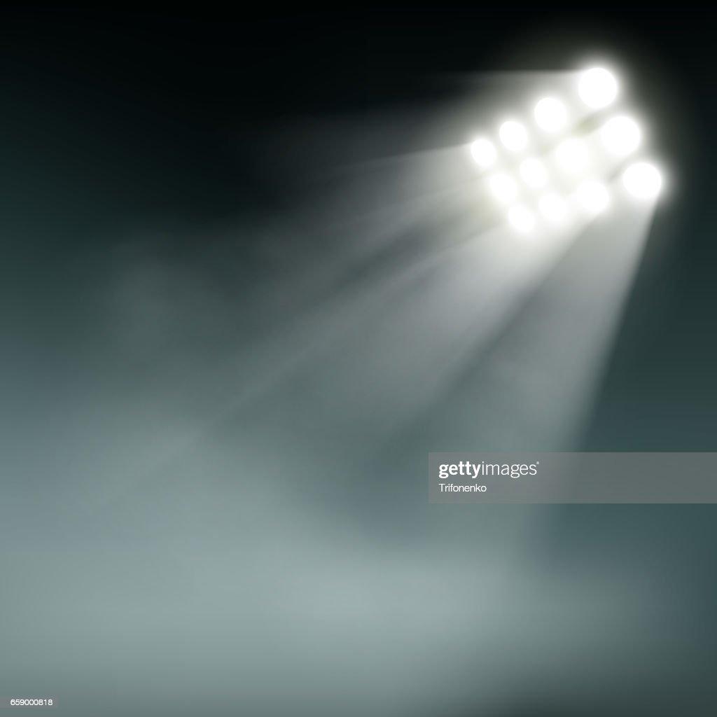 Stadium lights on a dark background.