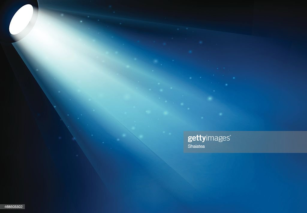 Stage spot light shining down with particles in the air