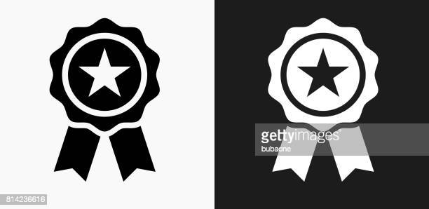 star ribbon icon on black and white vector backgrounds - incentive stock illustrations, clip art, cartoons, & icons