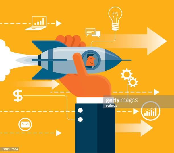 illustrazioni stock, clip art, cartoni animati e icone di tendenza di decollare. razzo hand holding - uomo d'affari - nuova impresa