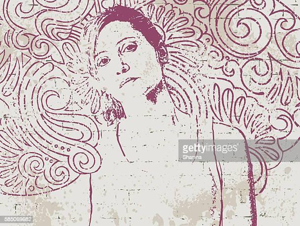 Stencil portrait on hand drawn wall