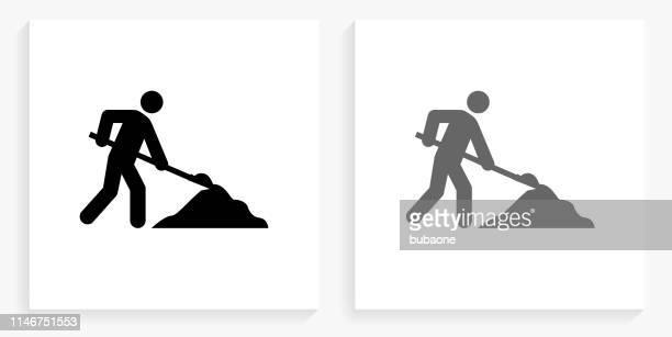 stick figure shoveling black and white square icon - winterdienst stock illustrations