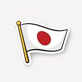Sticker flag of Japan on flagstaff