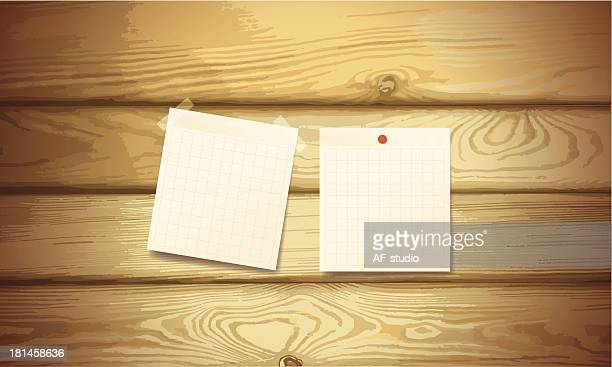 Sticky notes on wood background