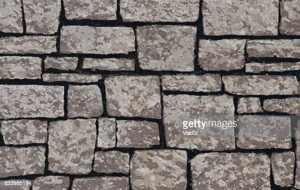 stone blocks brick wall textured background - brick stock illustrations