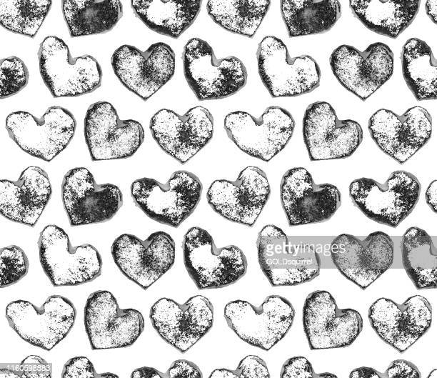 stone hearts isolated on a white piece of paper - seamless monochromatic pattern design - hearts made by handmade stamp with irregular and imperfect distribution of paint - irregular texturizado stock illustrations