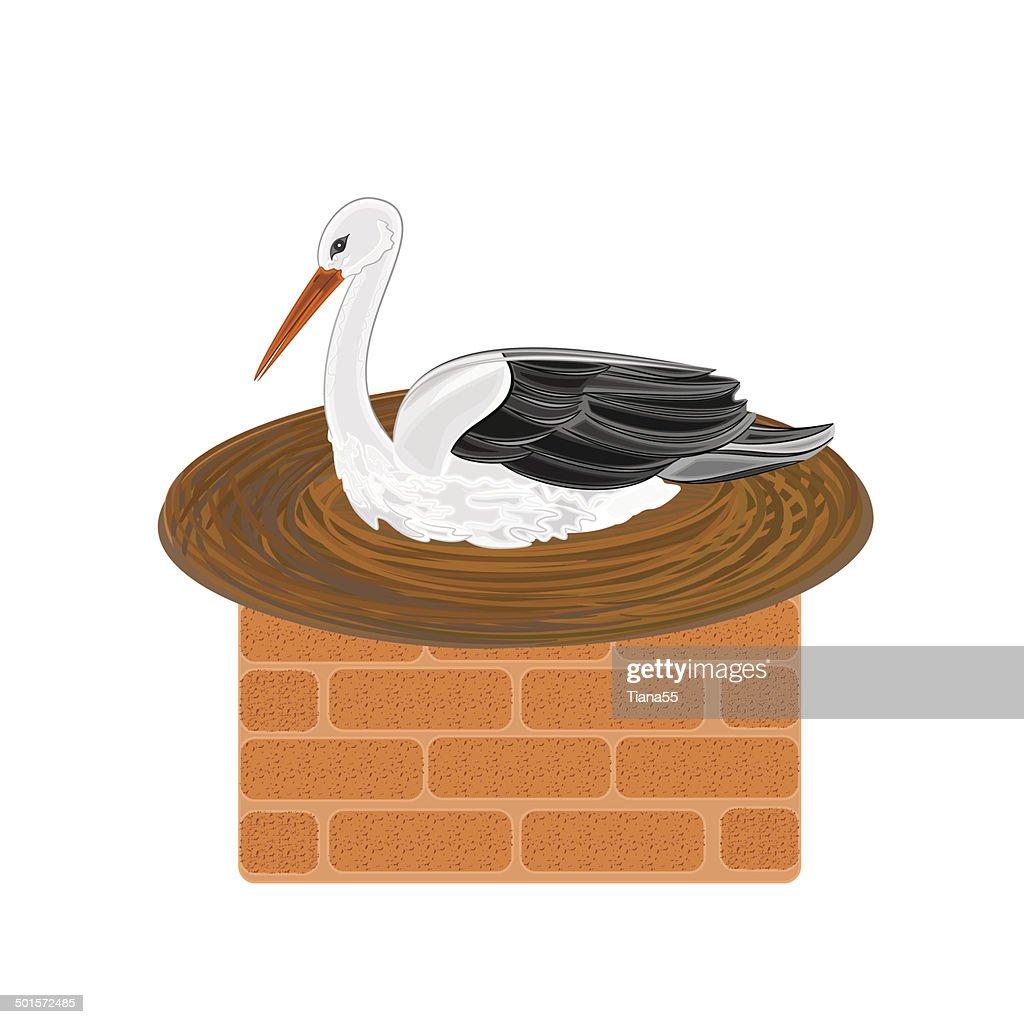 Stork and nest on a brick chimney