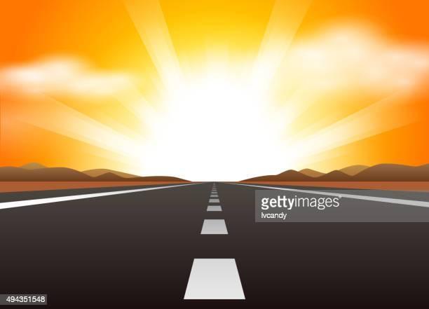 Estrada reta e nascer do sol