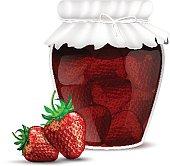 Strawberry jam in a jar and dewy fresh strawberries
