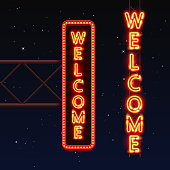 Street sign that says welcome.