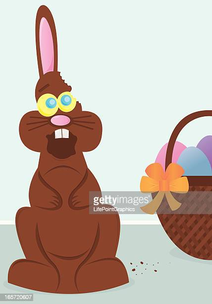 stressed chocolate easter bunny with ear bitten off - easter bunny stock illustrations, clip art, cartoons, & icons