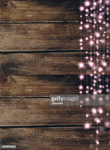 String of  pink lights with wooden background