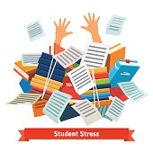 Student stress. Studying buried under a book pile