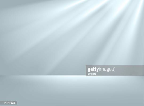 studio with spotlights - luminosity stock illustrations