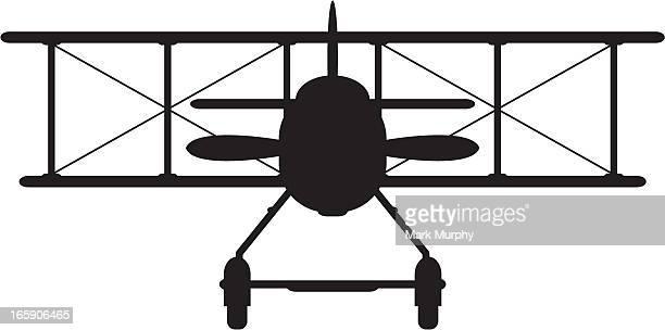 ww1 style military biplane silhouette - biplane stock illustrations, clip art, cartoons, & icons