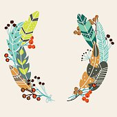 Stylish vector wreath made of vintage ethnic feathers and berries