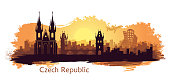 Stylized landscape of Prague with the main sights at ssunrise. Abstract skyline at sunrise with spots and splashes of paint
