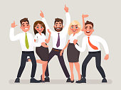 Successful business team. A group of happy office workers celebrating the victory. People with their hands up