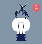 Successful businessmen on a bulb