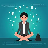 Successful young business woman or broker meditating or relaxing