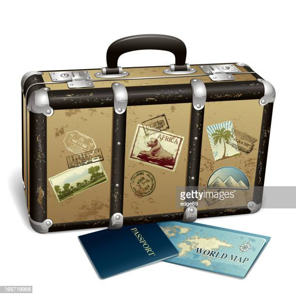 suitcase with stamps and postcards next to passport and map - next stock illustrations