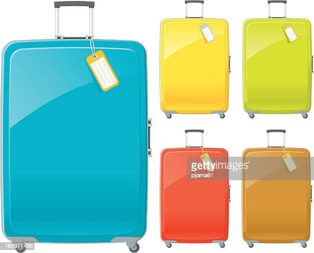 Suitcases in blue, yellow, green, red and brown with tags