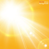 Summer background with a magnificent summer sun burst with lens flare. Space for your text
