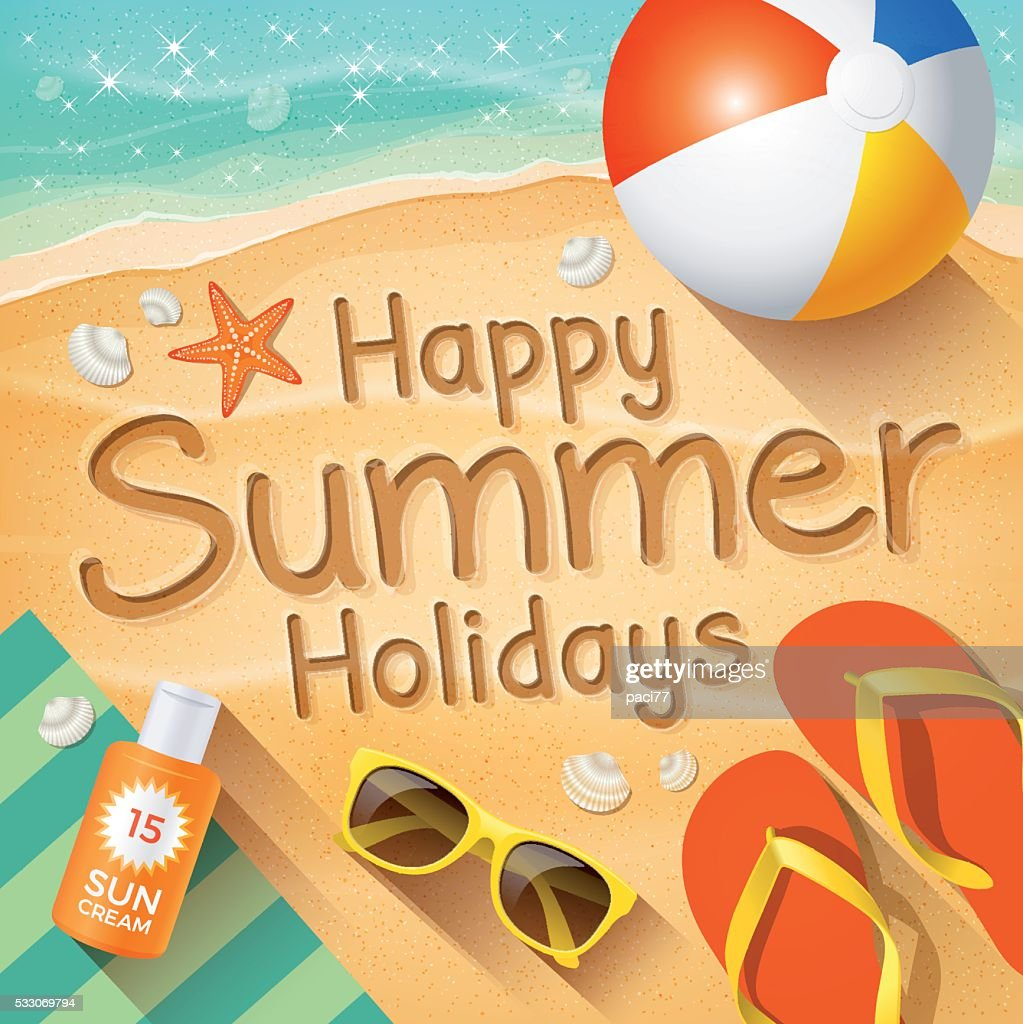 "Summer Background with text on sand ""Happy Summer Holidays""."