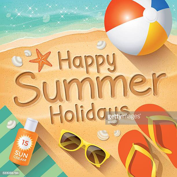 """Summer Background with text on sand """"Happy Summer Holidays""""."""