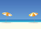 Summer beach and orange beach umbrella on blue gradient sky background  with copy space for your text.