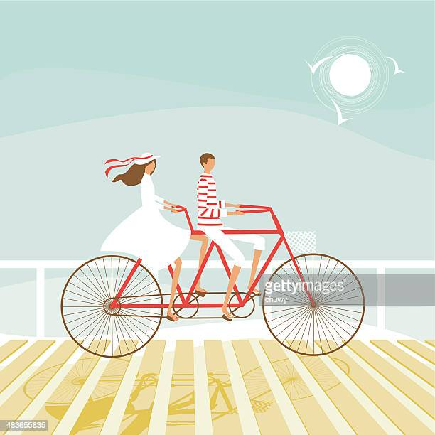 ilustraciones, imágenes clip art, dibujos animados e iconos de stock de par ciclismo en verano en la playa - chuwy