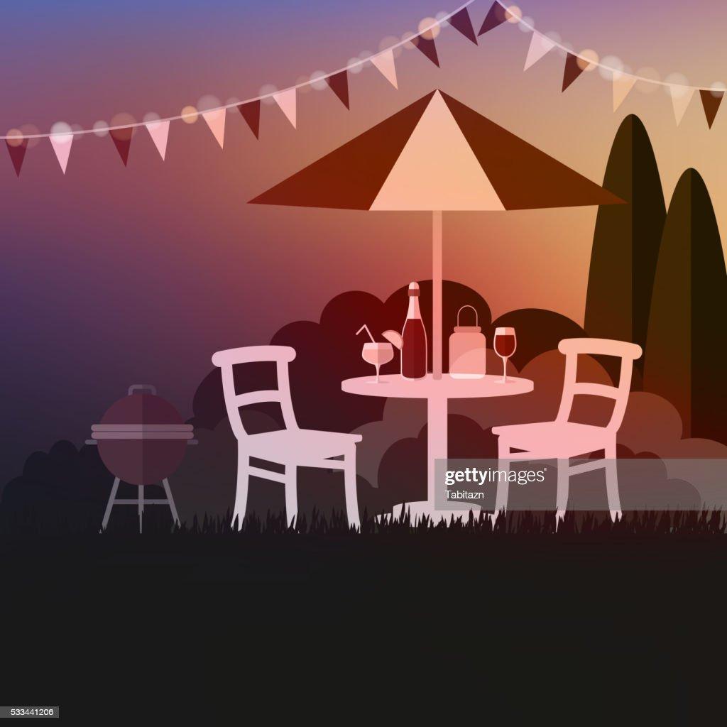 Summer garden party. Summer outdoor barbecue. Sunset background.